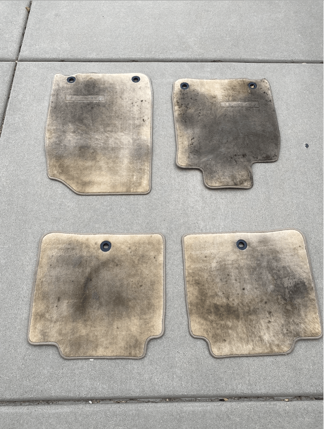 Dirty car carpets before being detailed