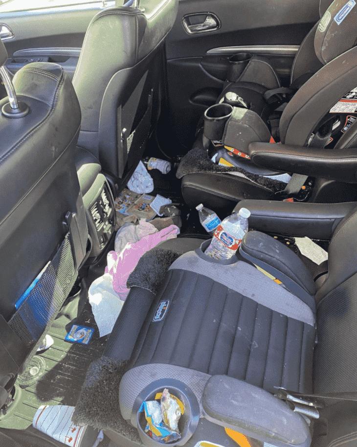 Dirty interior of auto mobile before VIP Utah car detailing.