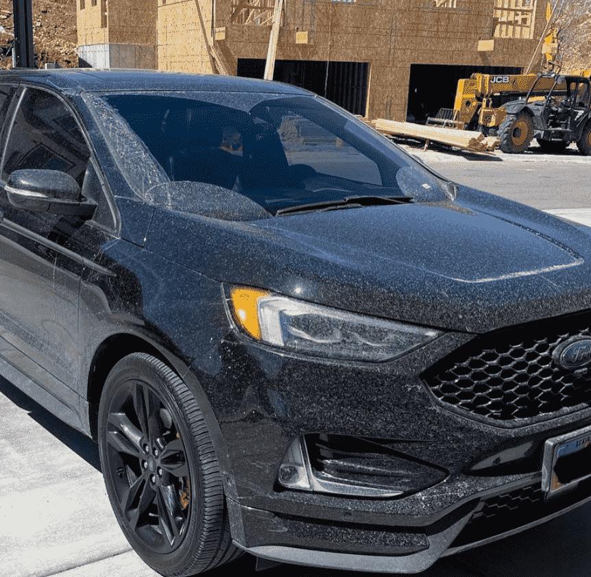 Black Ford Car before car detailing in Utah.