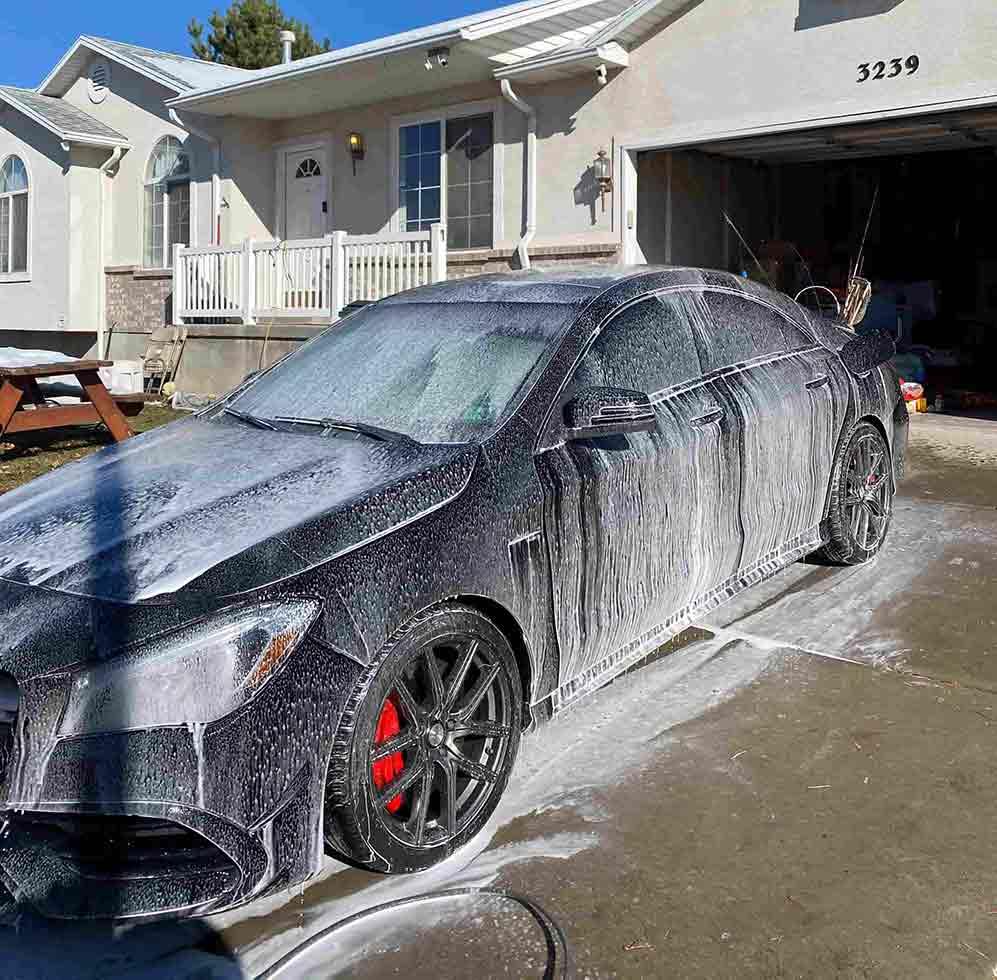 Car being washed in Roy Utah by VIP Detailing.