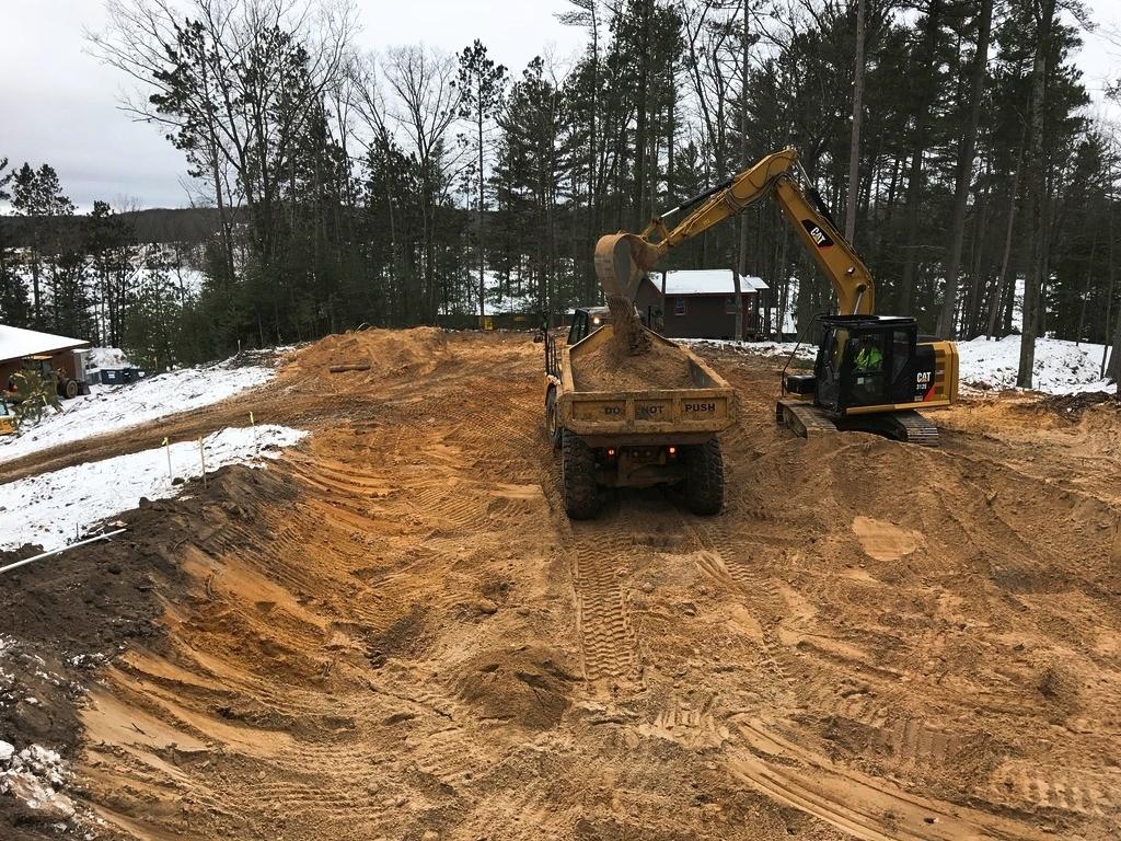 Excavator loading the dump trailer