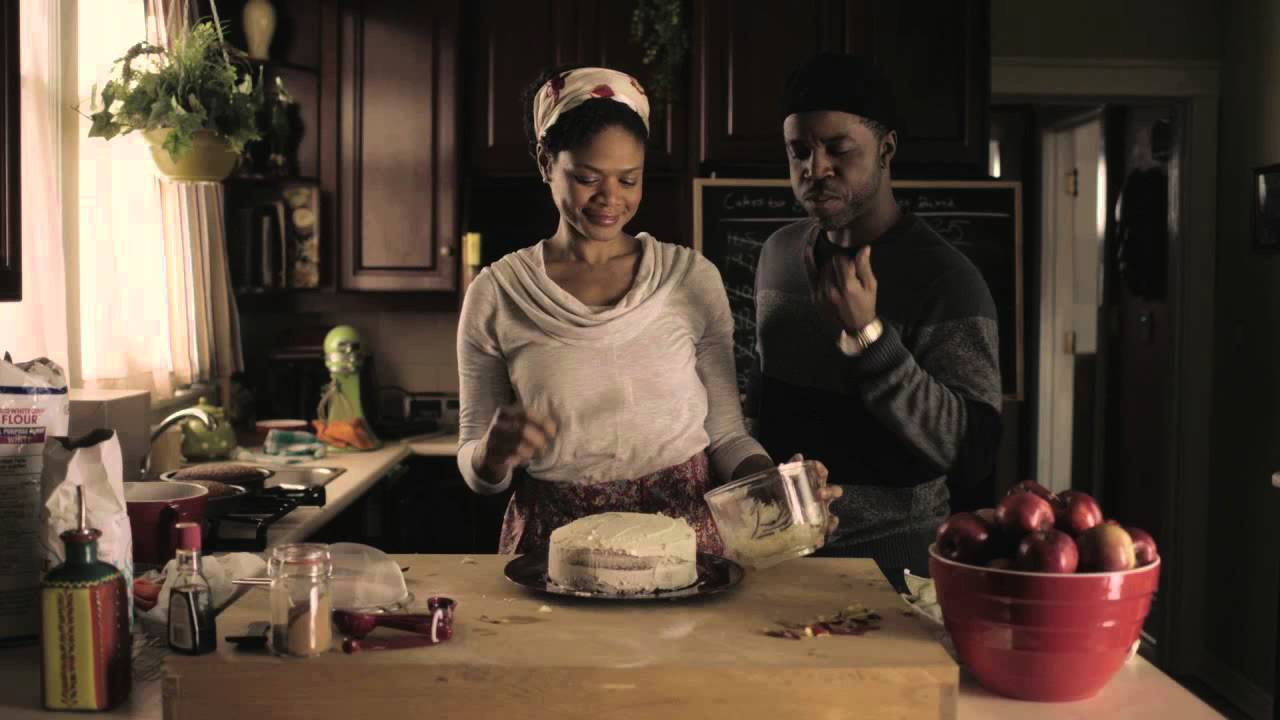 Black women making a cake
