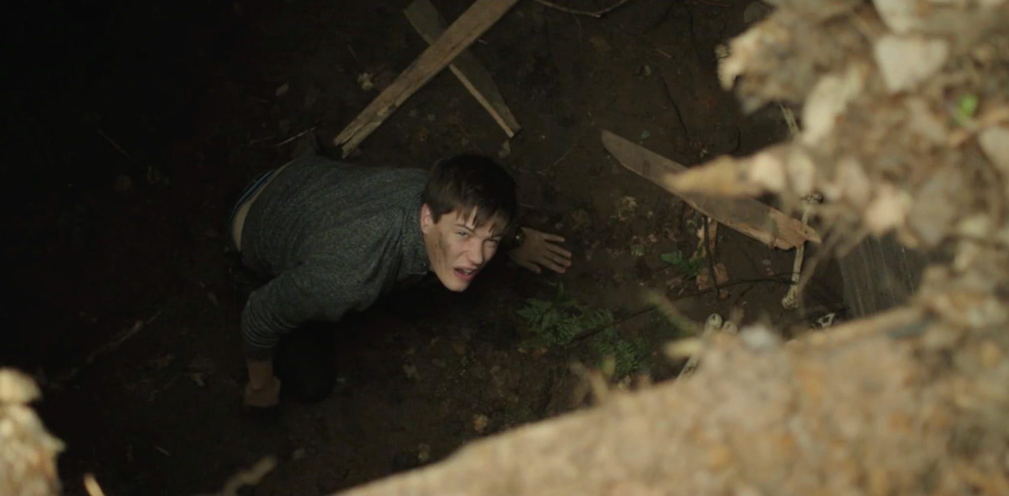 Teenage boy at bottom of pit