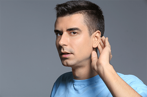 Man suffering from early hearing loss