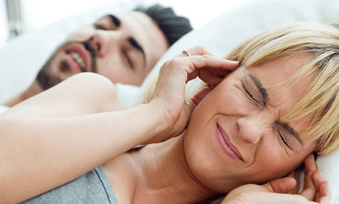 Man and partner suffer from snoring at night