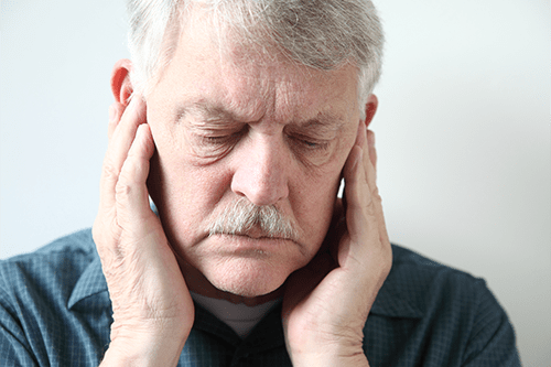 Man suffering with tinnitus