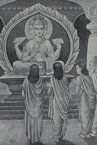 people standing around looking at a statue of Buddha