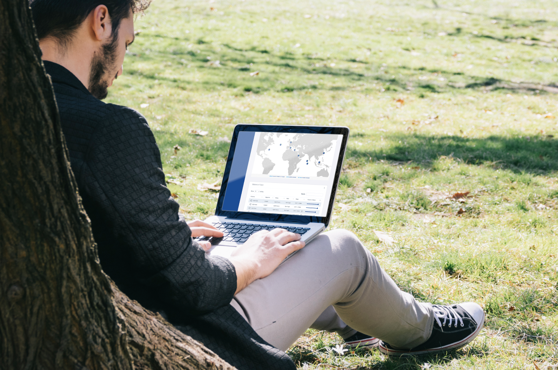 Man using Pathway on a laptop whilst sitting in a park