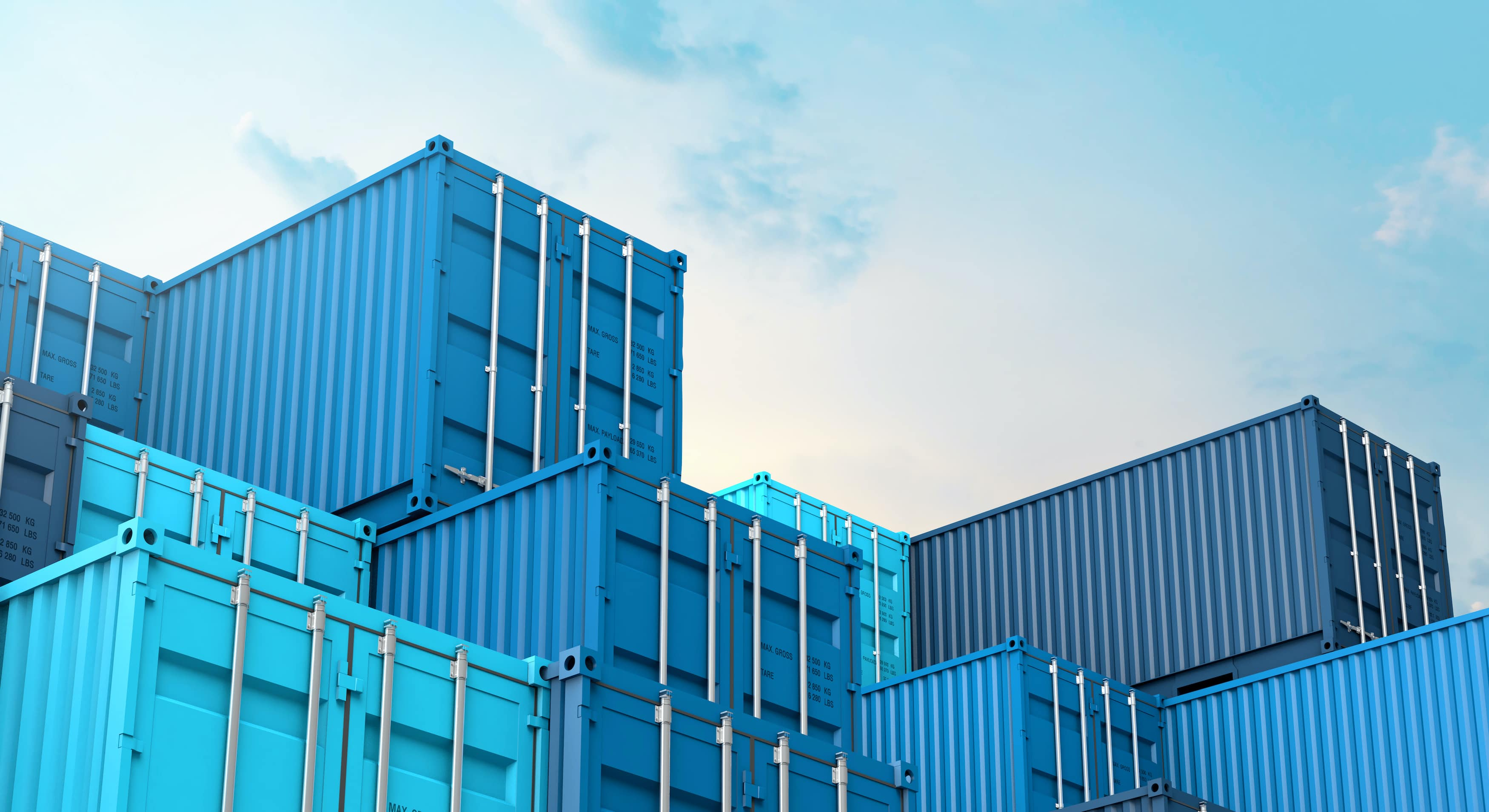 stack of blue shipping containers at dock