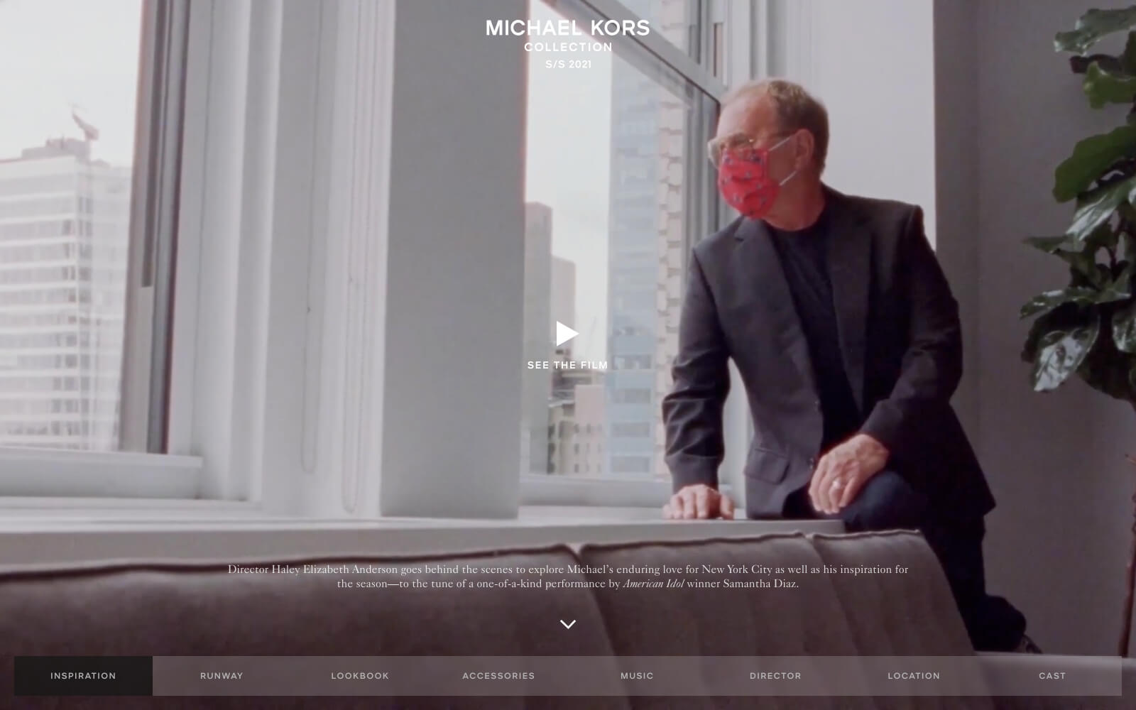 The Michael Kors Collection website features a minimal, fullscreen background image of a fashionable man wearing a red designer face mask glaring out of a build window towards the future.