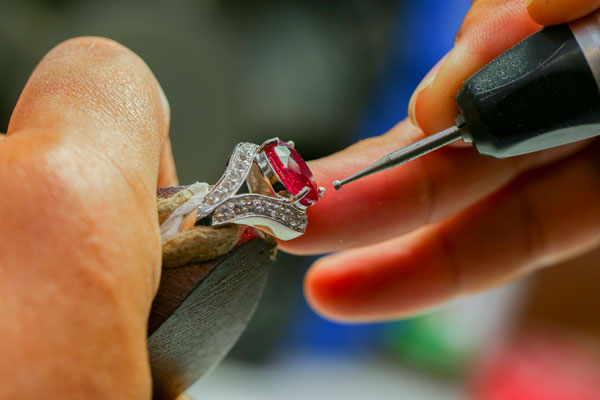 Putting back a stone on a ring as a careful repair.