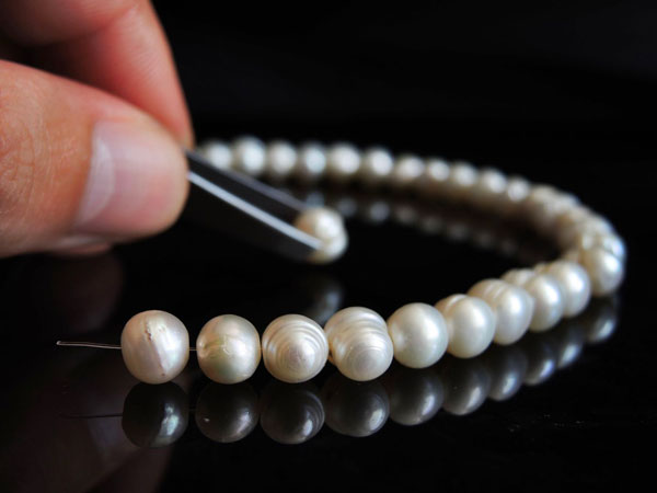 Repair on a pearl necklace.
