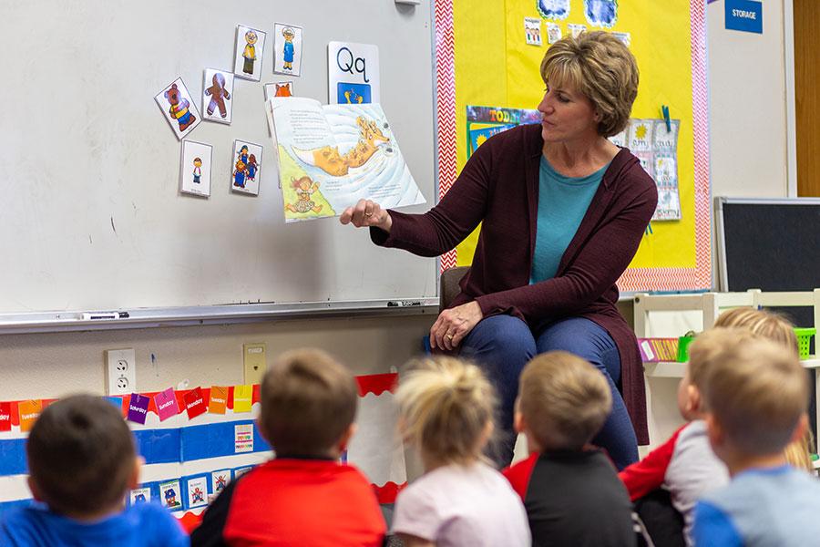 preschool teacher reading to students