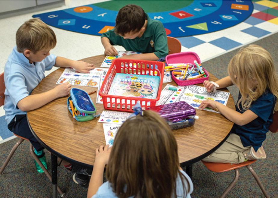 kindergarten children working around a table