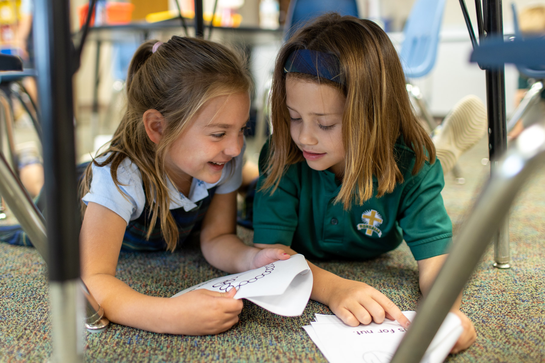 primary school girls reading together
