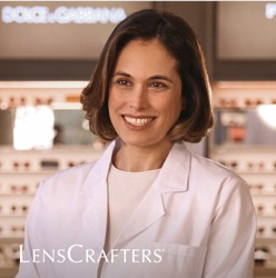 Optometrist standing in front of a LensCrafters store