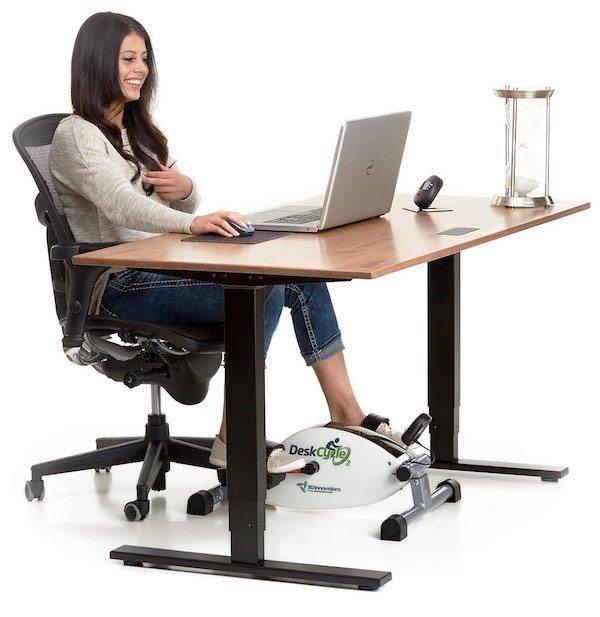 Woman using deskcycle bike at desk