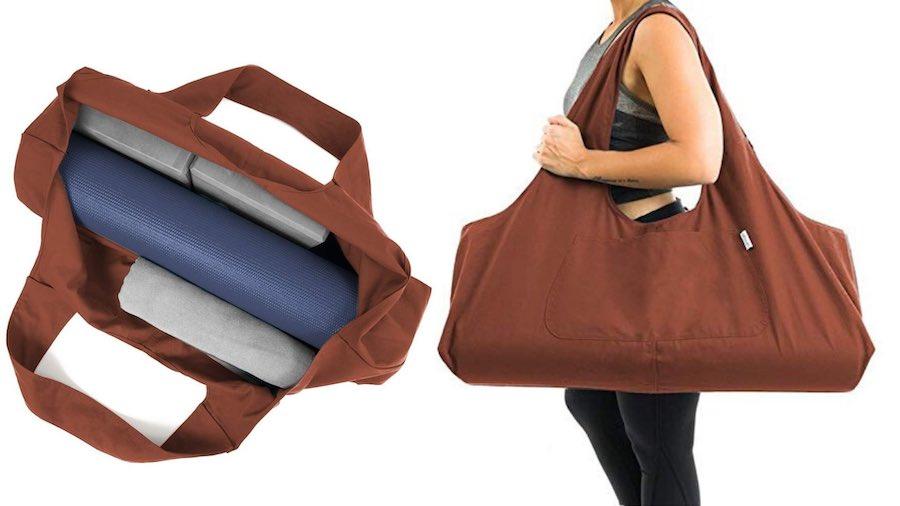 YogiiiTotePRO yoga bag with yoga mat and yoga blocks inside. Women carrying the yoga bag.