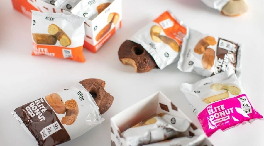 Packages of individually wrapped and partially open Eliet Sweets protein donuts.