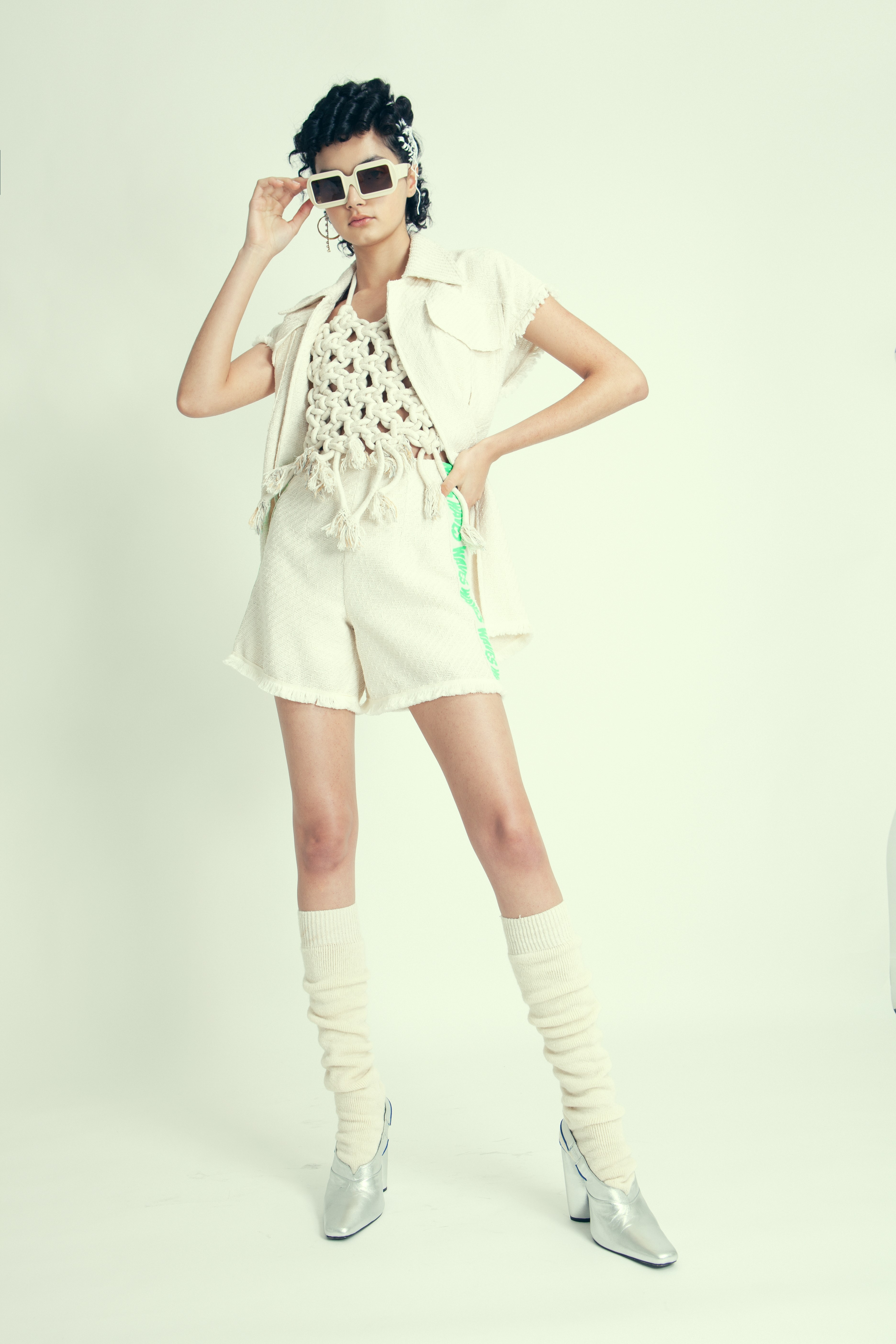 Kiana look 2 Ivory sunglasses : Pawaka Beige knot top : Noémie Devime Beige knitted sleeveless jacket : Nocturne Beige Knitted short with neon green « wave » pattern on the side : Nocturne Socks : stylist own Silver slingback pumps : Adult