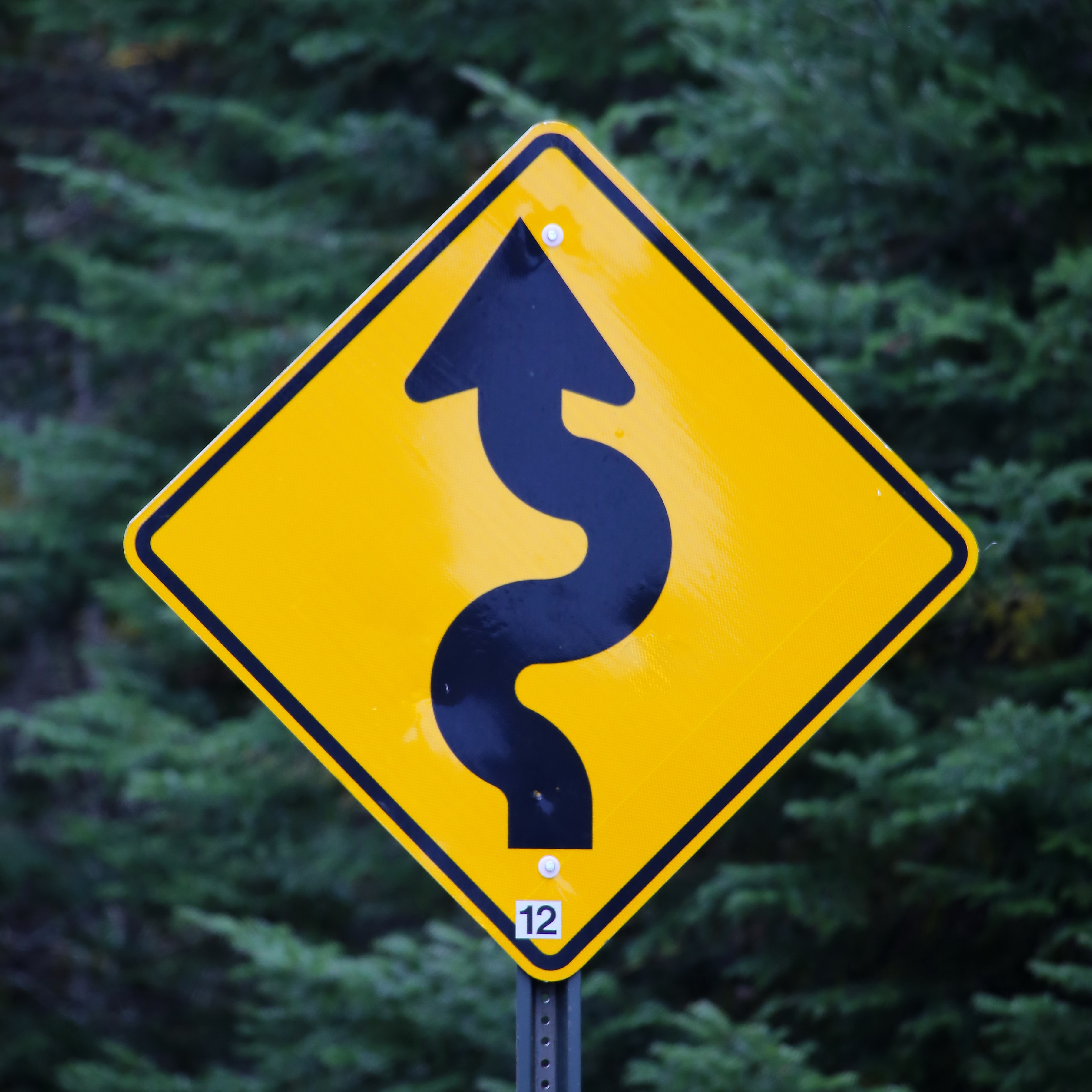 a road sign describing a long and winding road