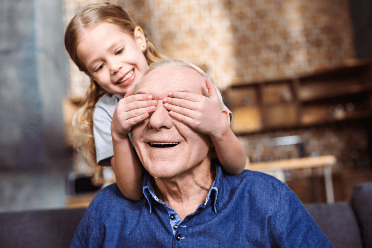 Grandpa and grand daughter playing a game