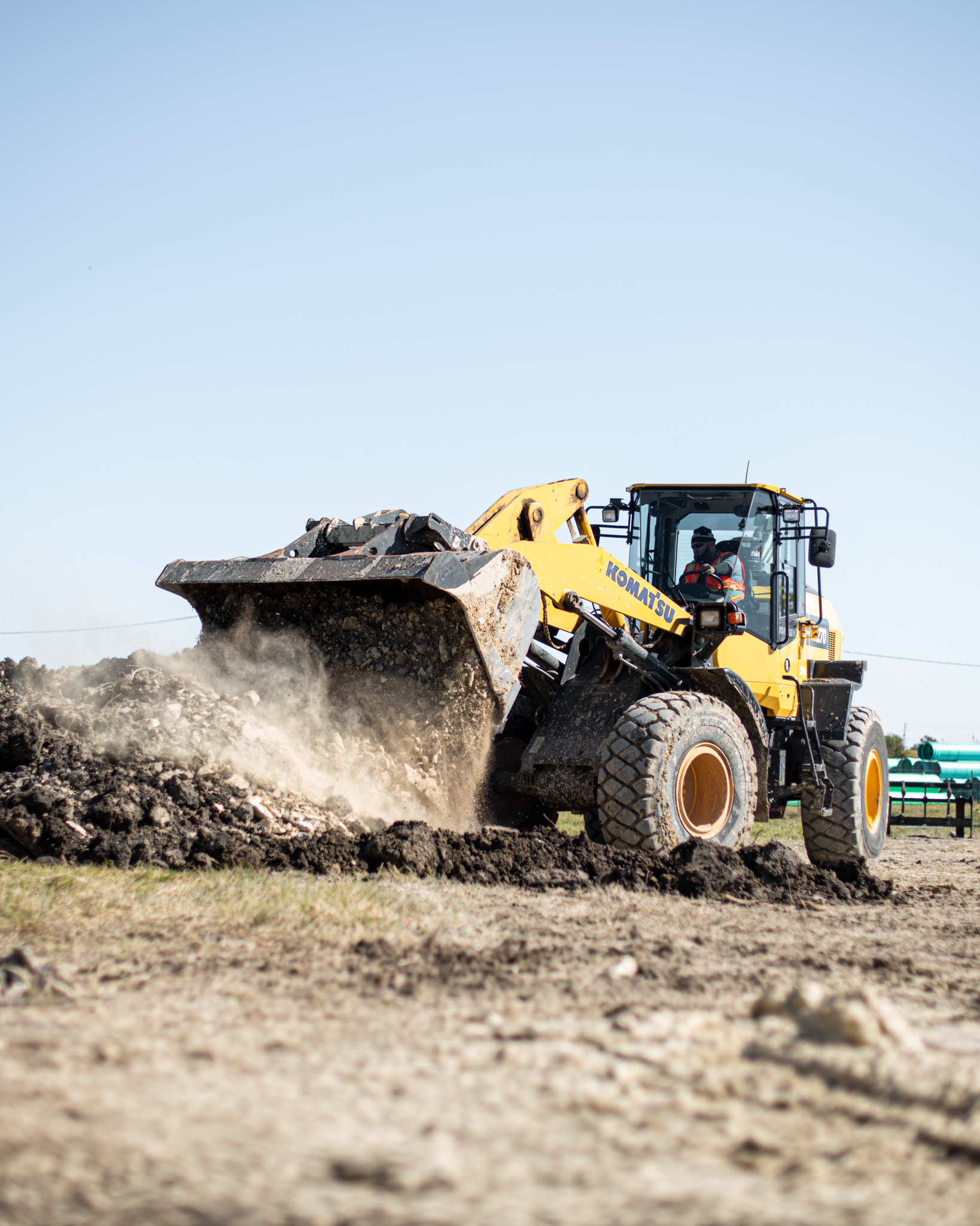 Komatsu wheel loader moving dirt.