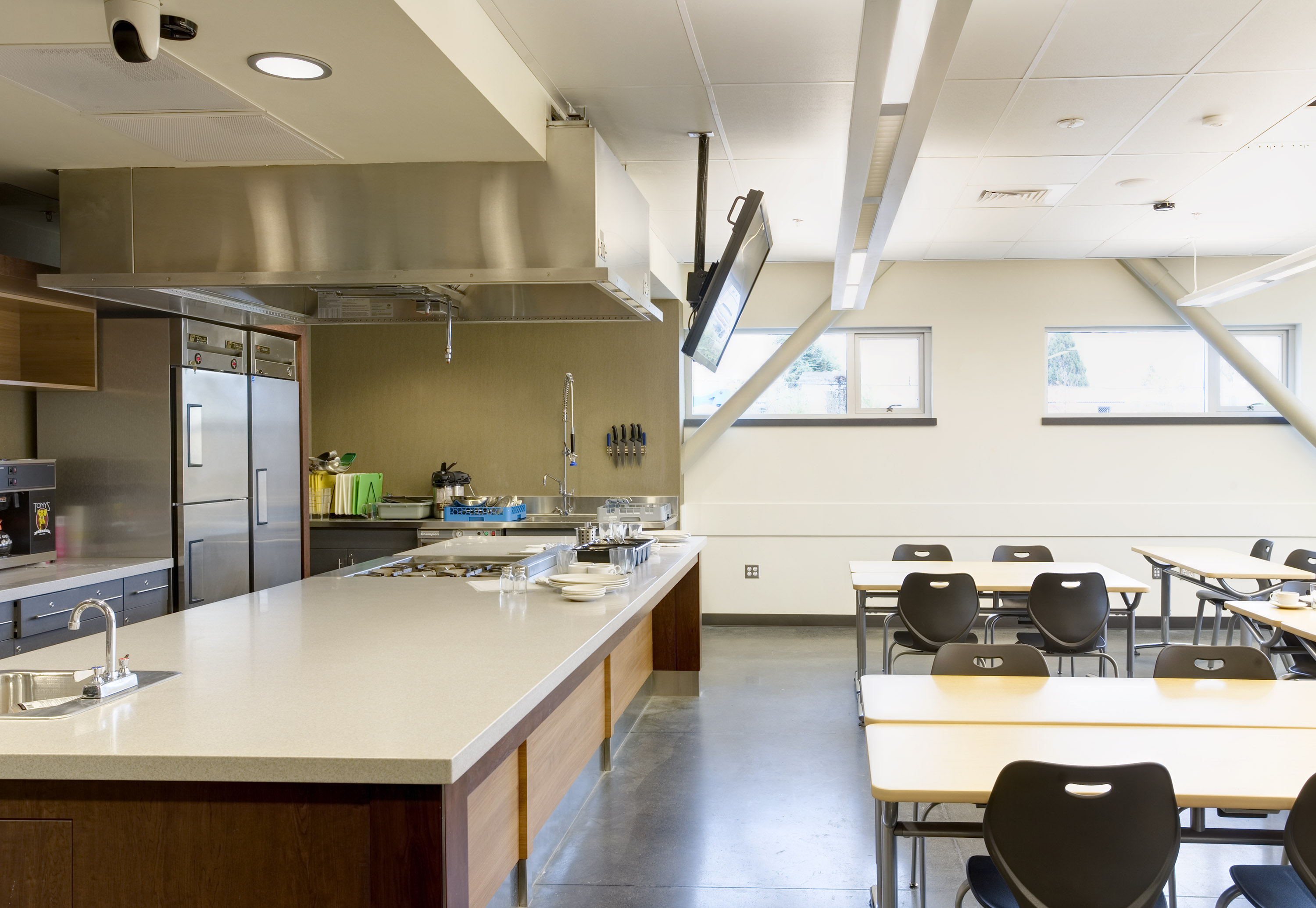Showing the culinary classroom, both the main work station and table and chairs.