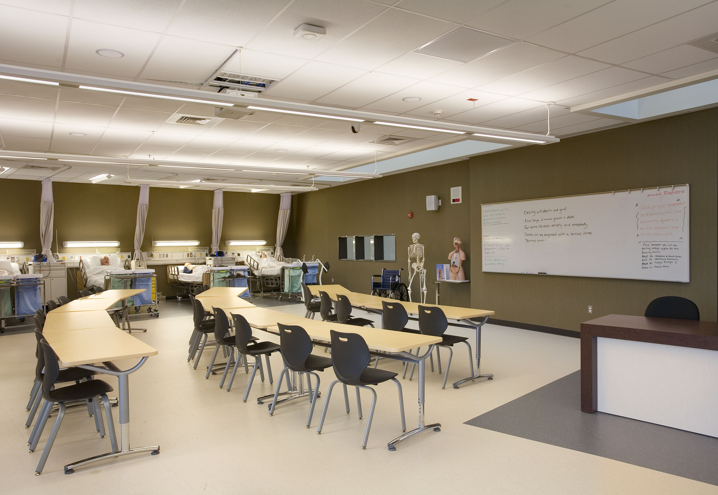 One of the medical training classrooms, including a student learning area and hospital beds.