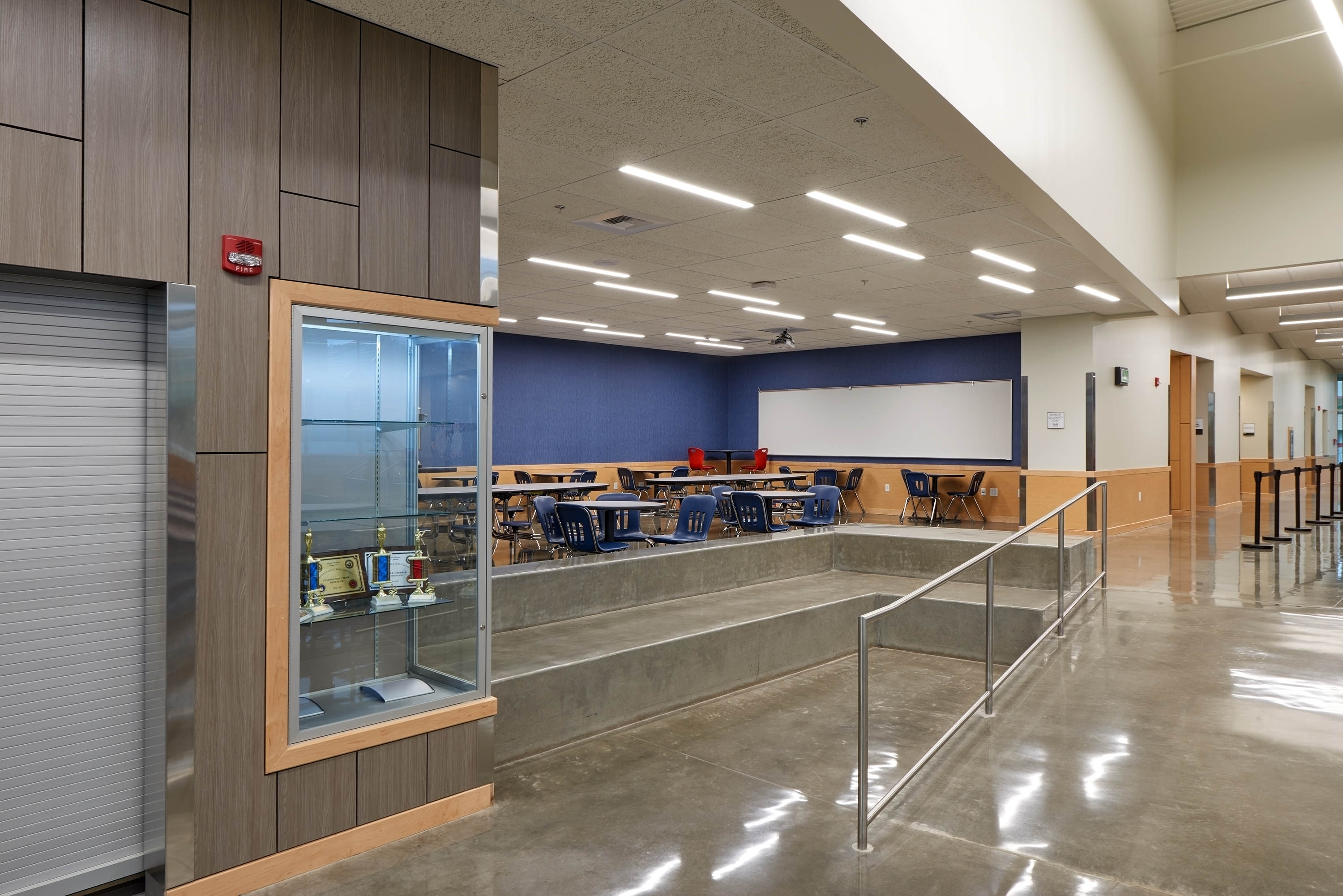 Flex space for students and additional bunch seating built into the slope of the floor.