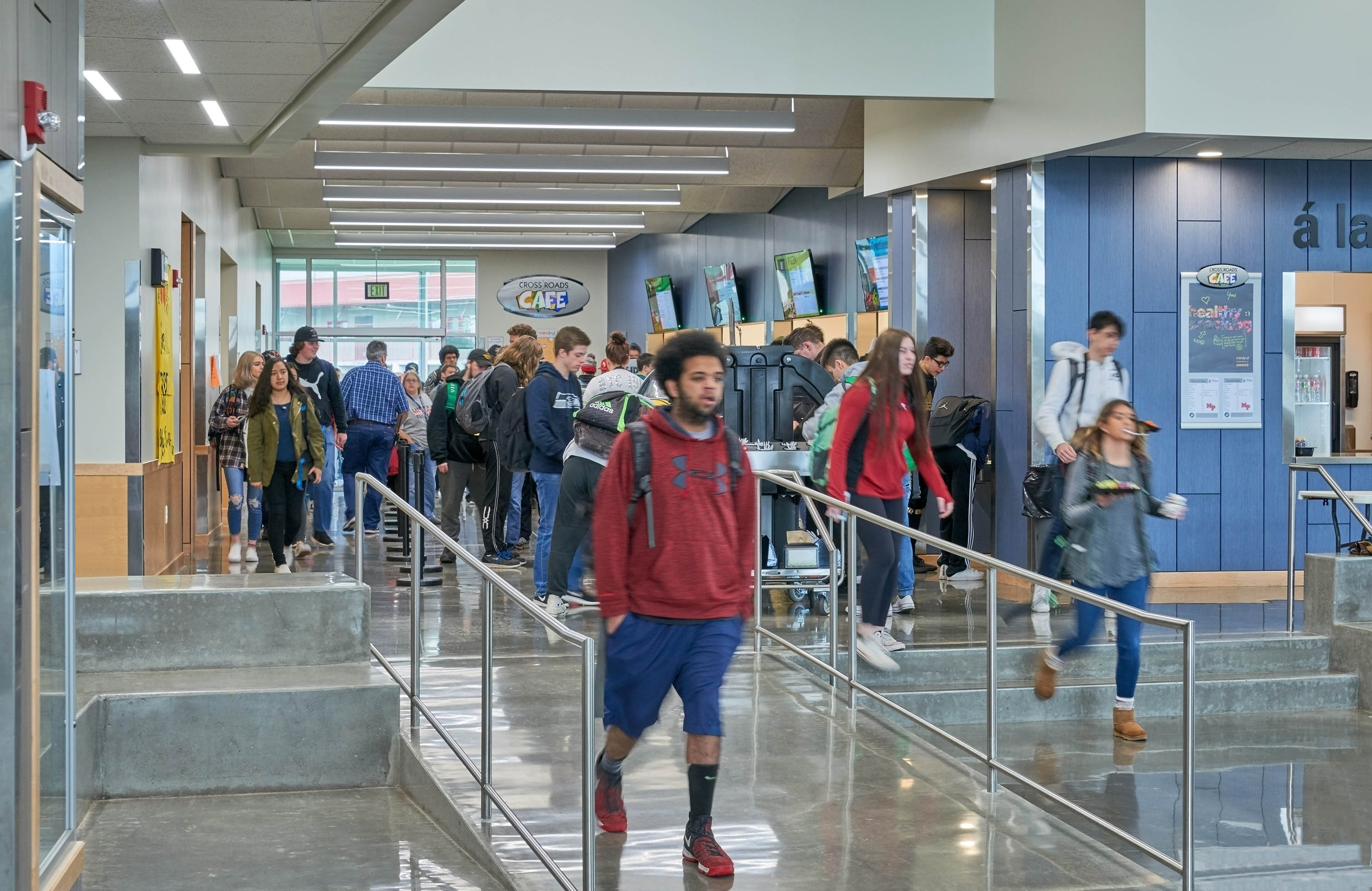 Students entering the Commons on the ramp and stairs.