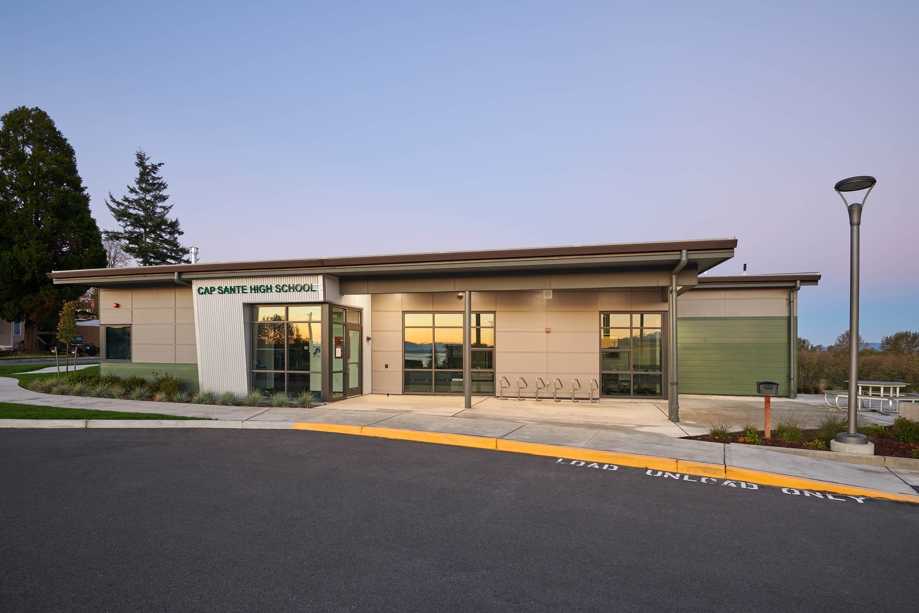 Exterior wide photo of the school and it's entry way.
