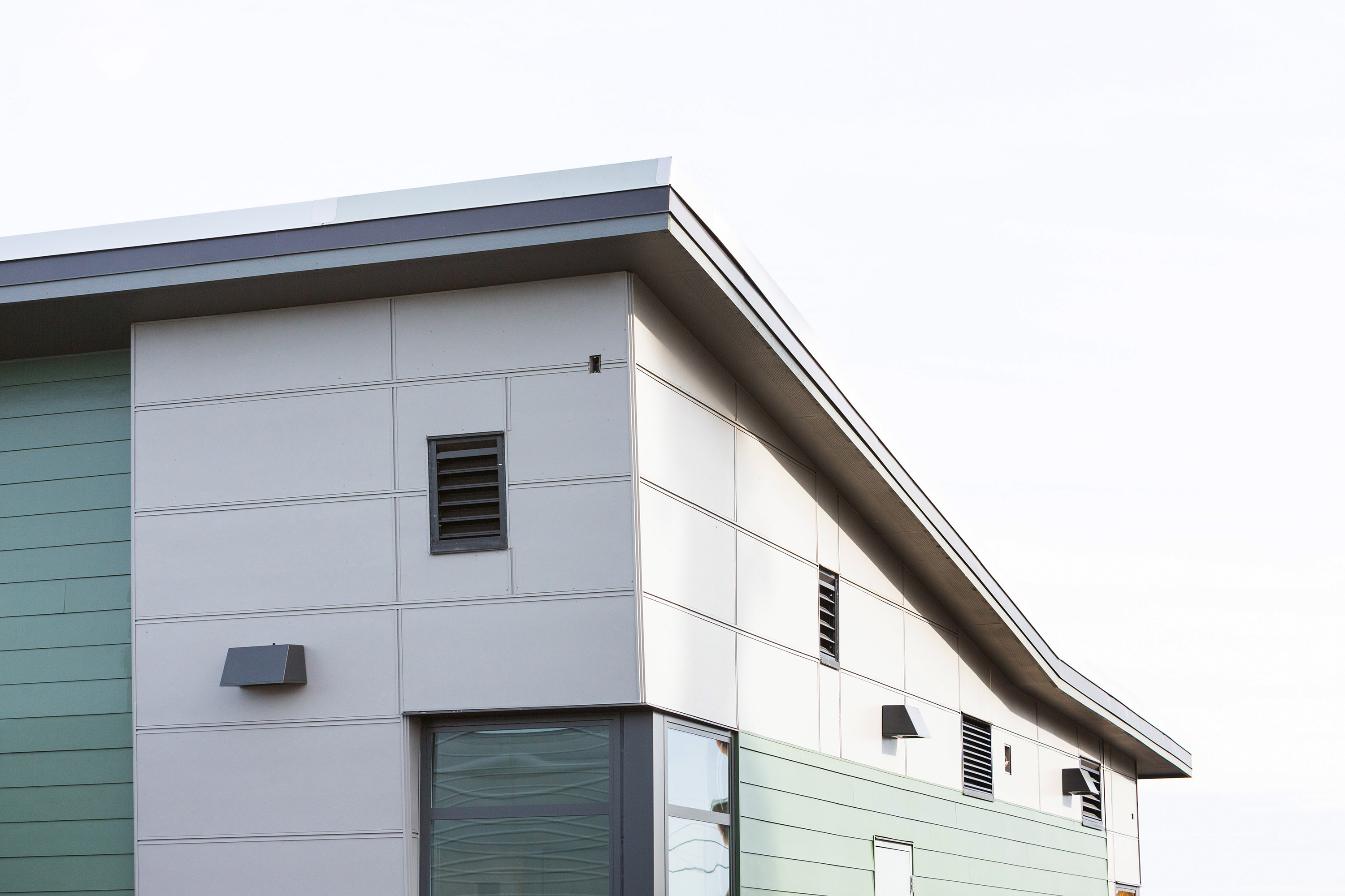 Close up of the school's exterior side paneling and roof.