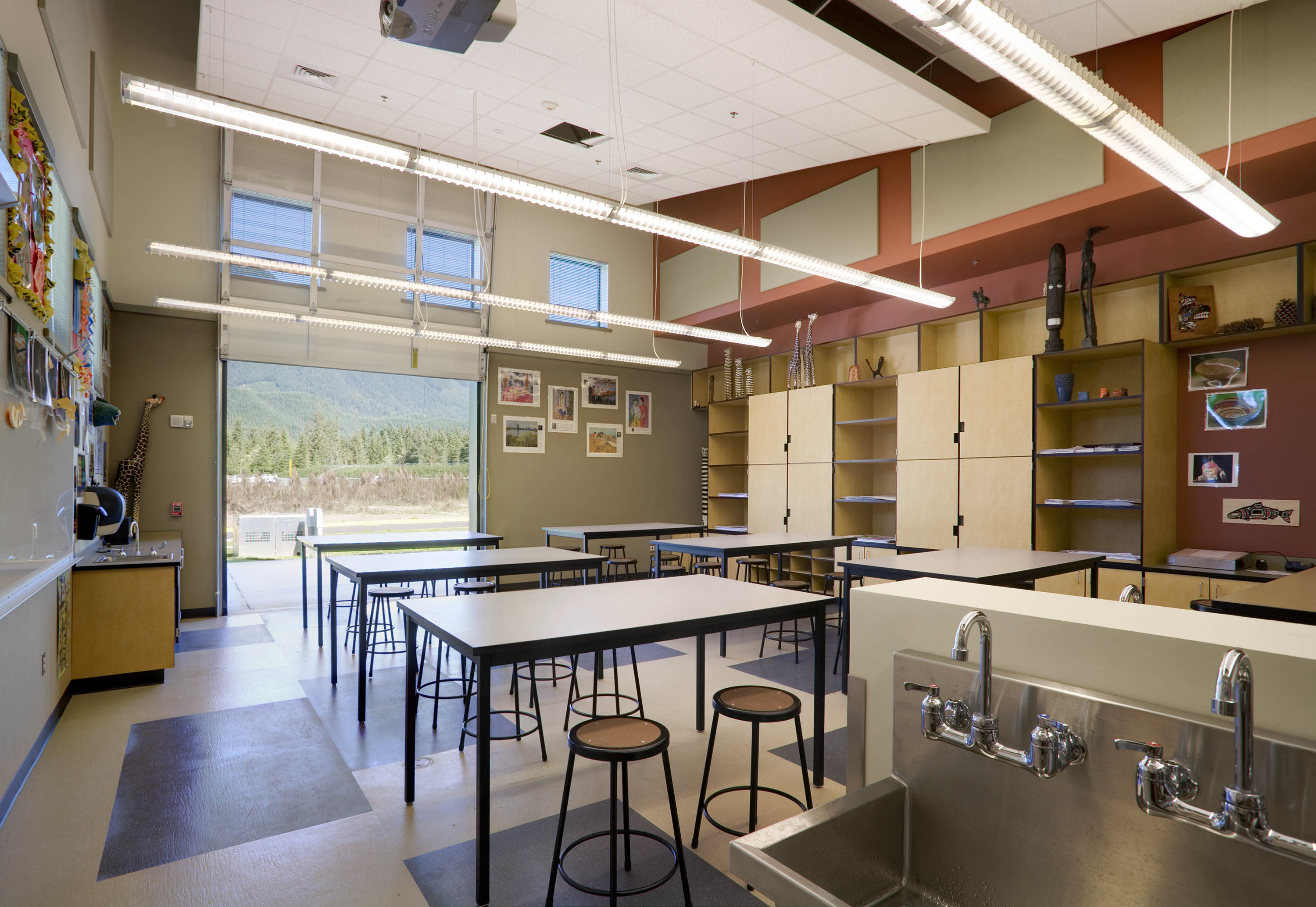 The art classroom with the garage door open, views of the mountain partially visible.