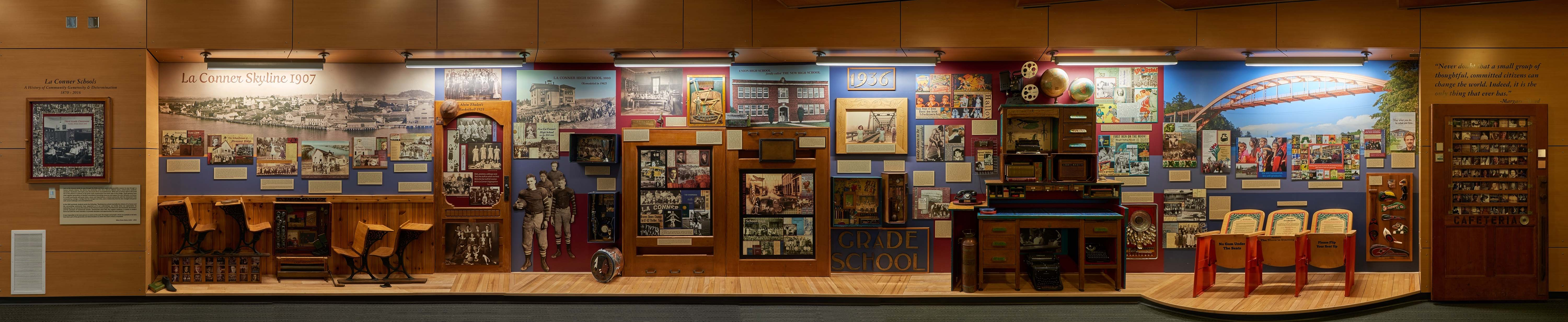 A panorama photo of the display case showing the school's history.