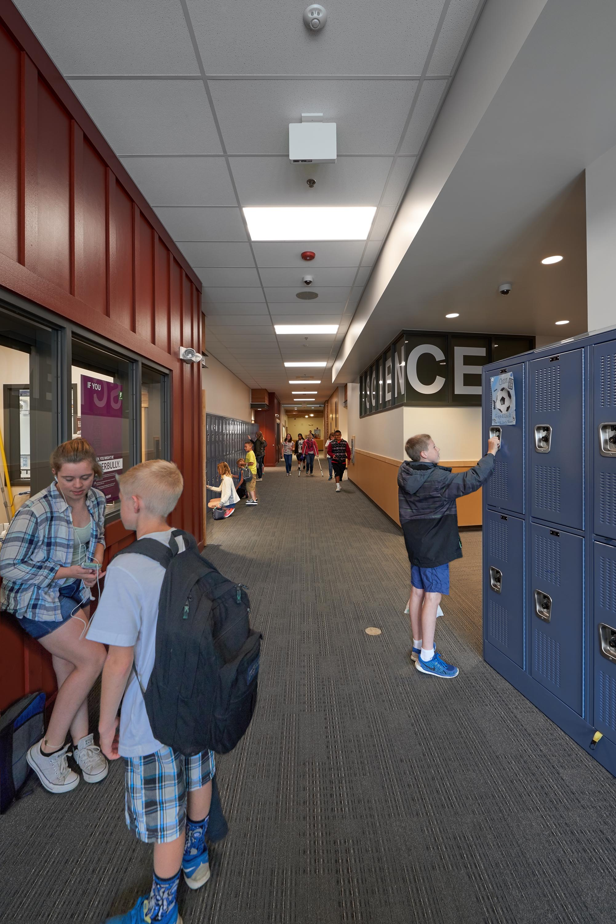 Students talking and using their lockers.