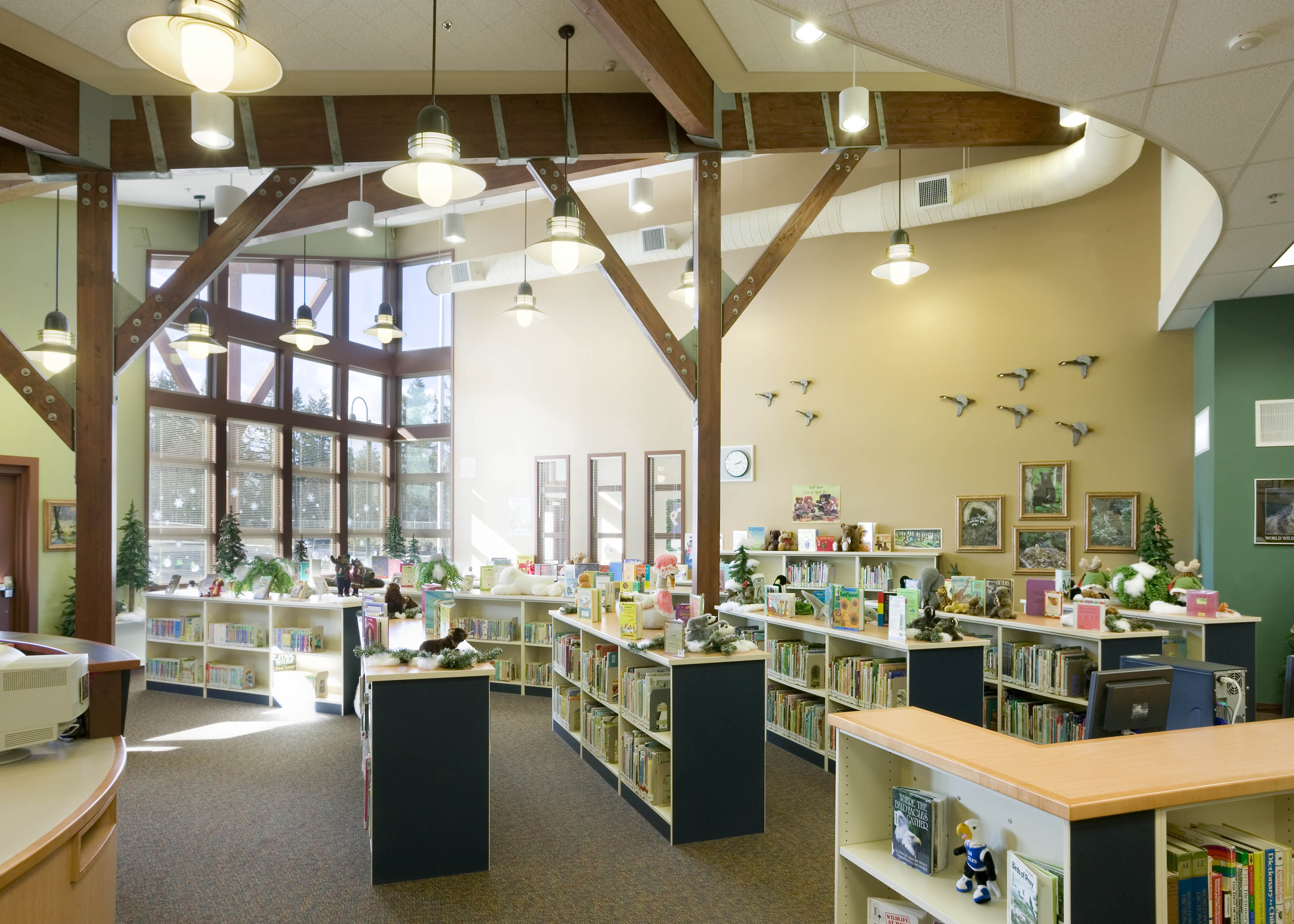 Wide photo of the library with natural light flooding in.