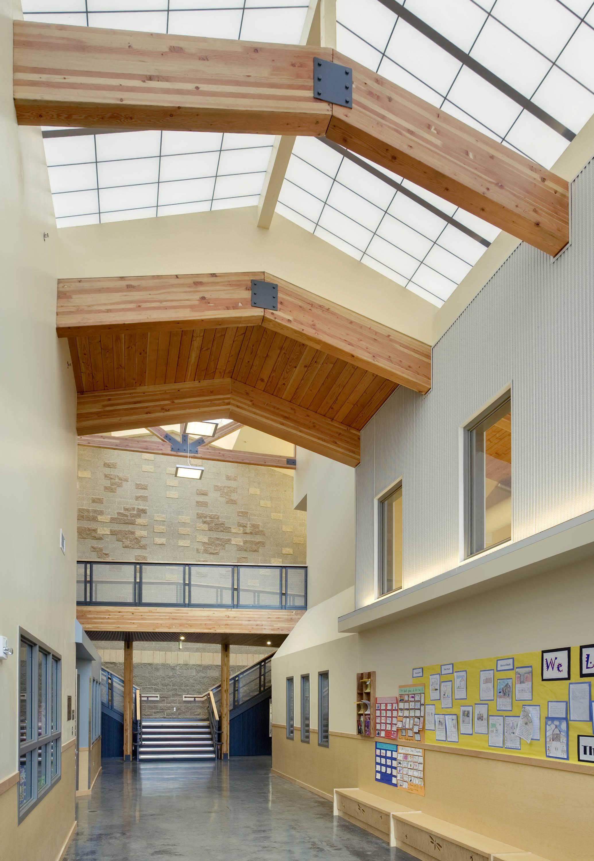 Main hallway with skylights and wood beams.