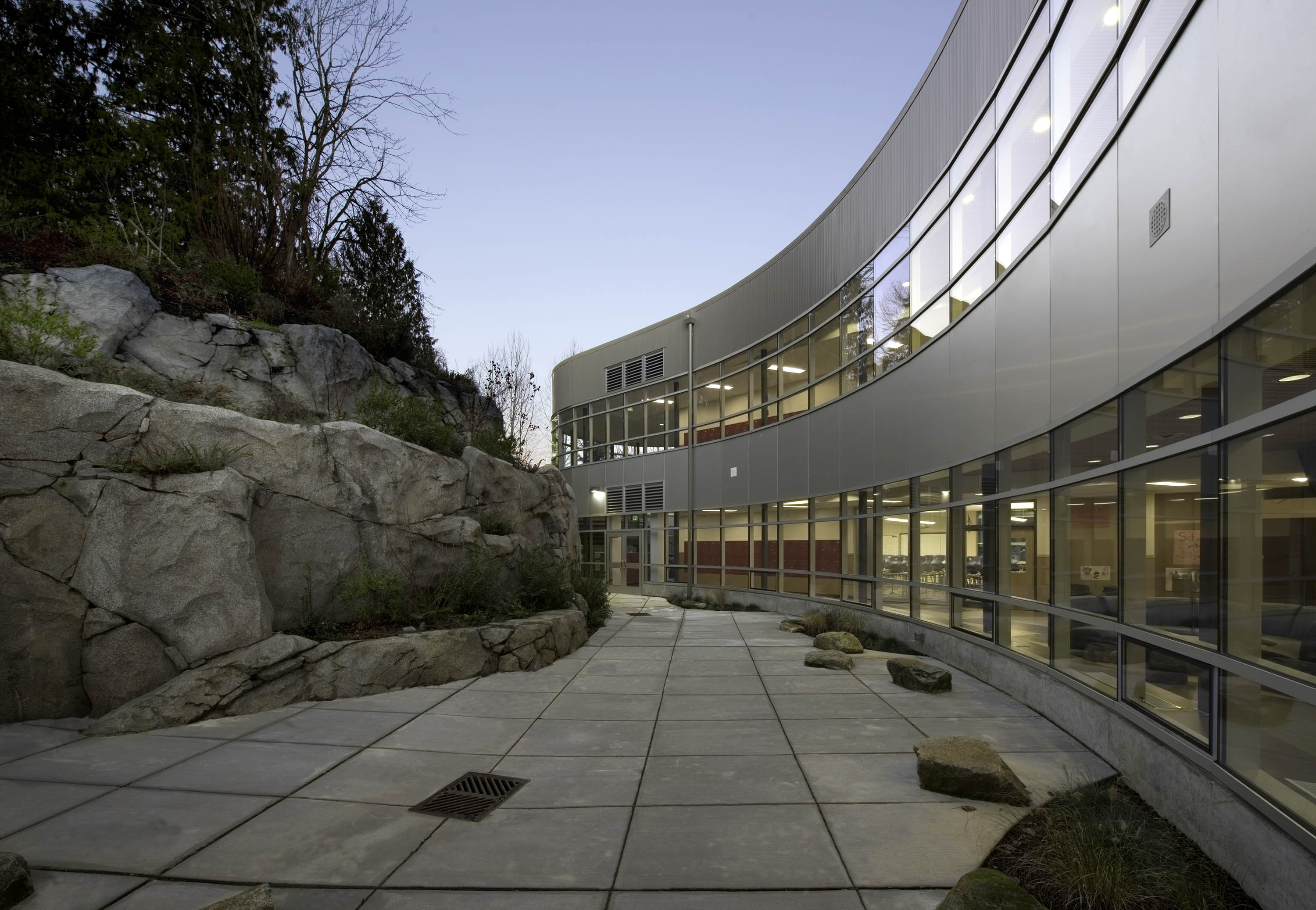 Exterior photo including the building and a rock feature.