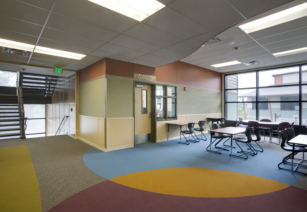 Flex space for students with a brightly colored floor.