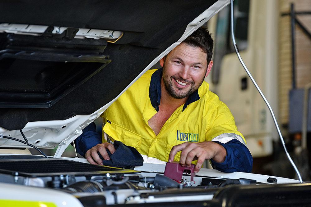 A man wearing ultrafleet uniform smiling