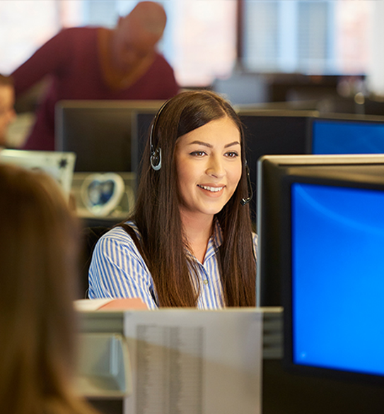 Woman answering phones in a call center