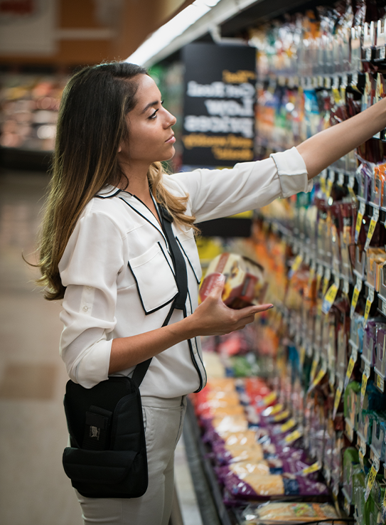 Merchandiser restocking shelves