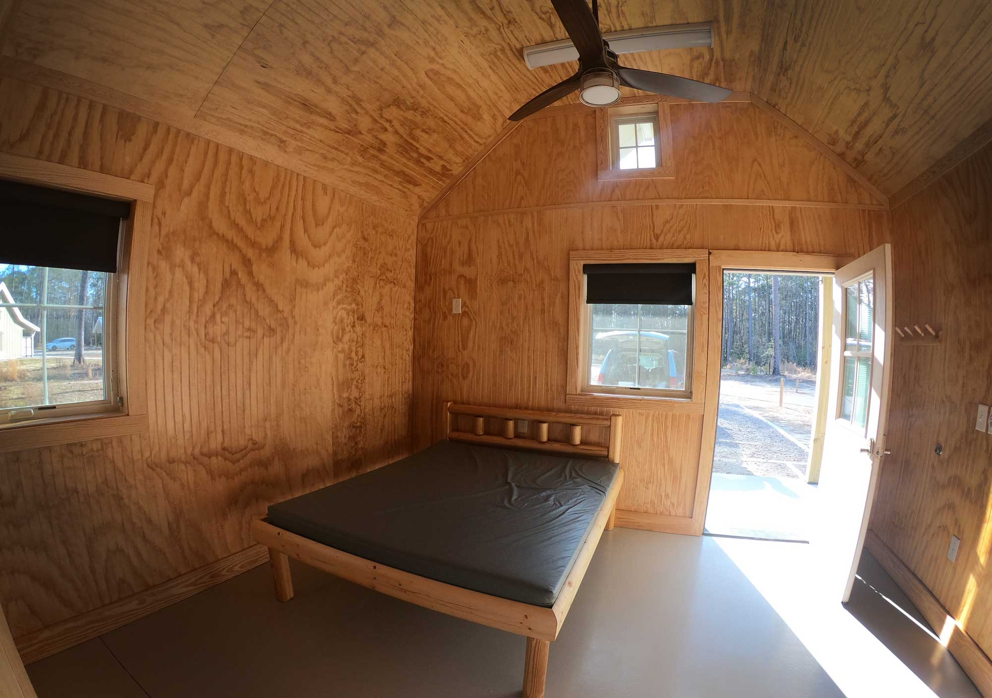 Interior of Goose Creek State Park cabin with queen bed and vaulted ceilings