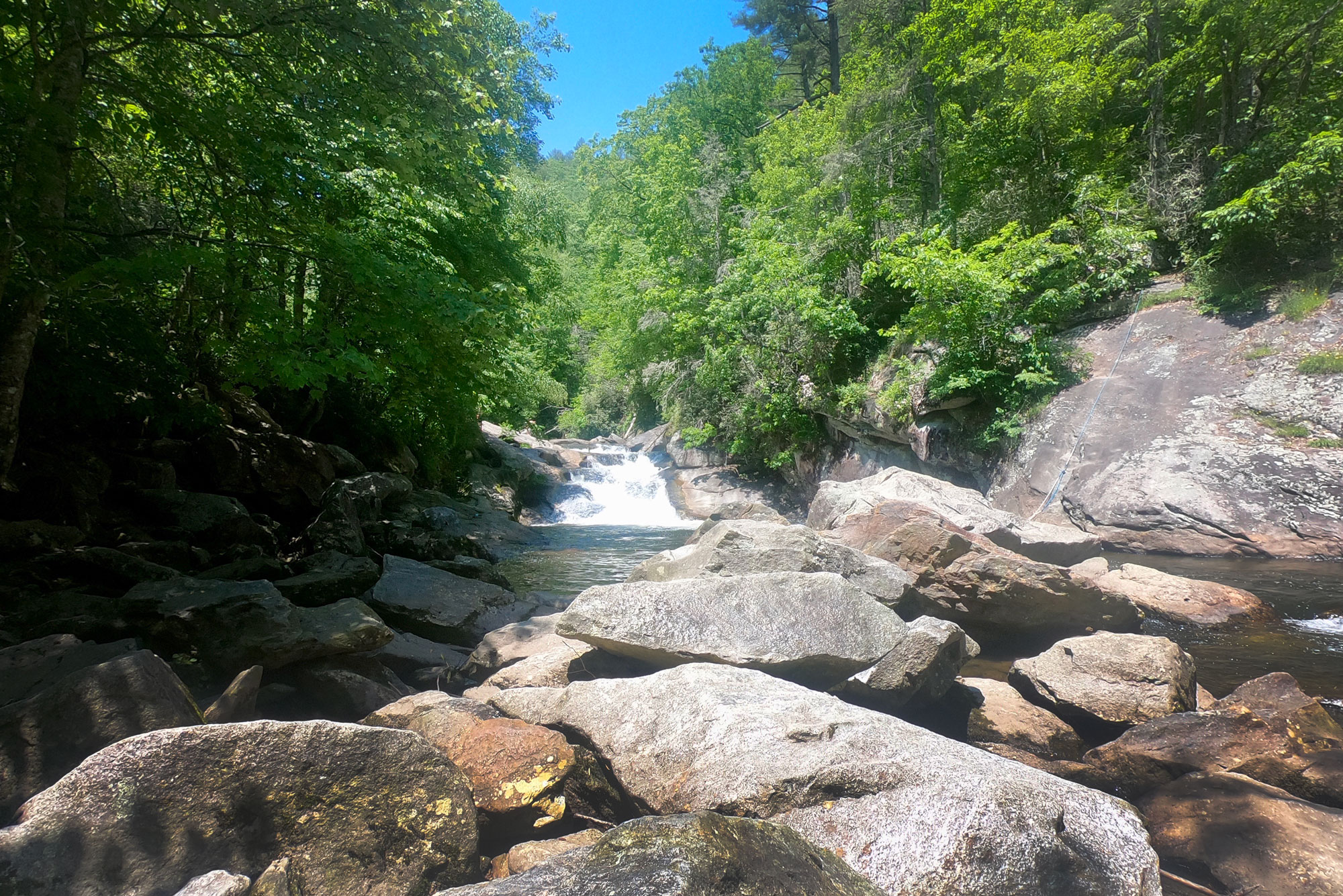 Bust Your Butt Falls swimming hole off Highway 64 near Standing Indian Campground