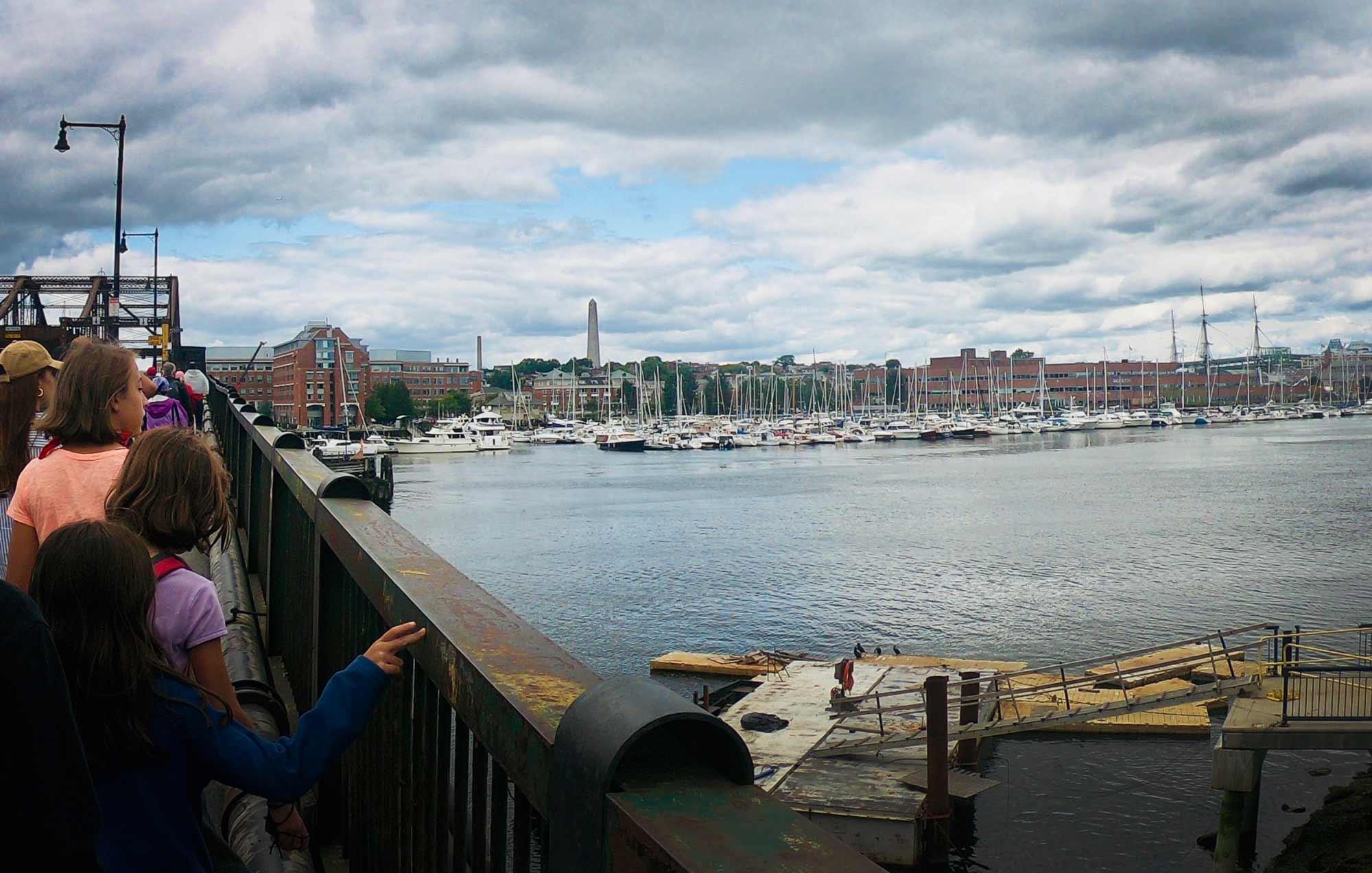 People walking along pedestrian path on Charlestown Bridge in Boston, Massachusetts