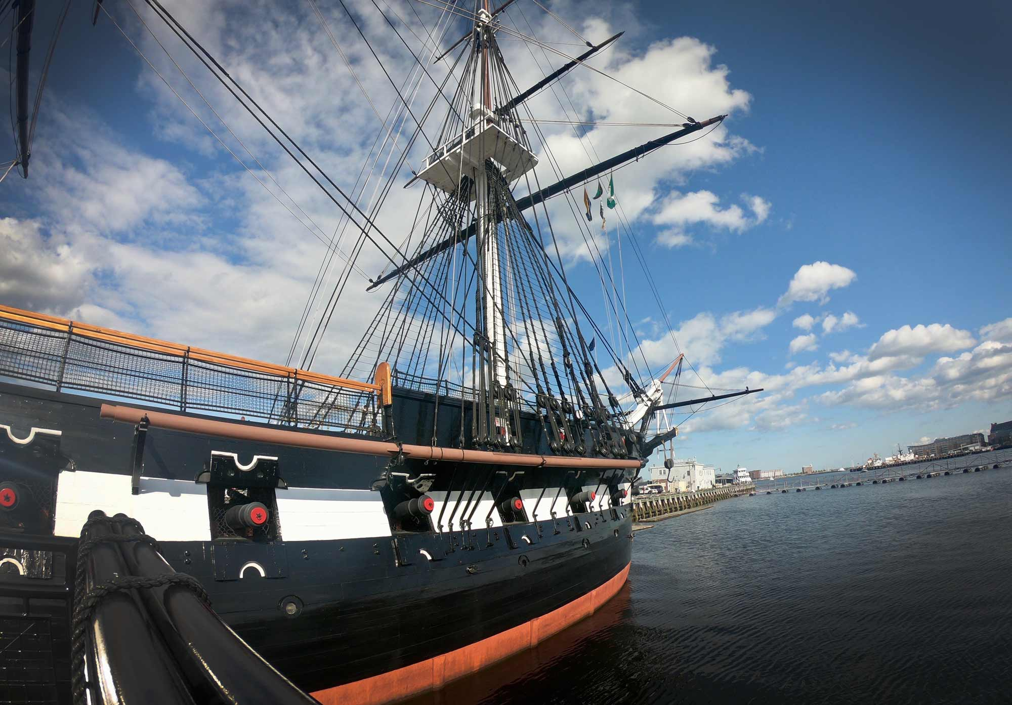 Exterior of USS Constitution with blue sky along the Freedom Trail in Boston, Massachusetts
