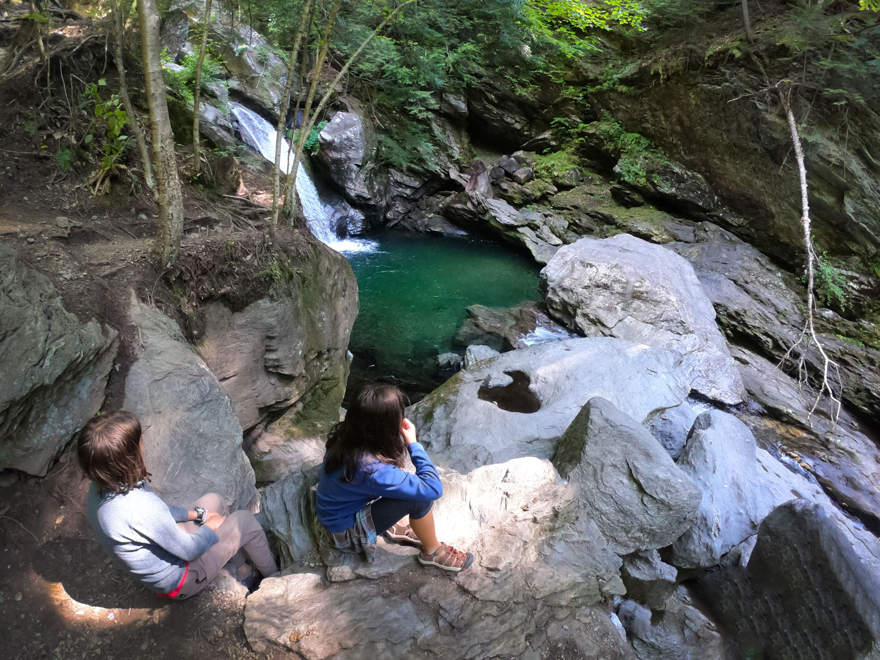 Two girls looking at the green pool at Bingham Falls, Vermont