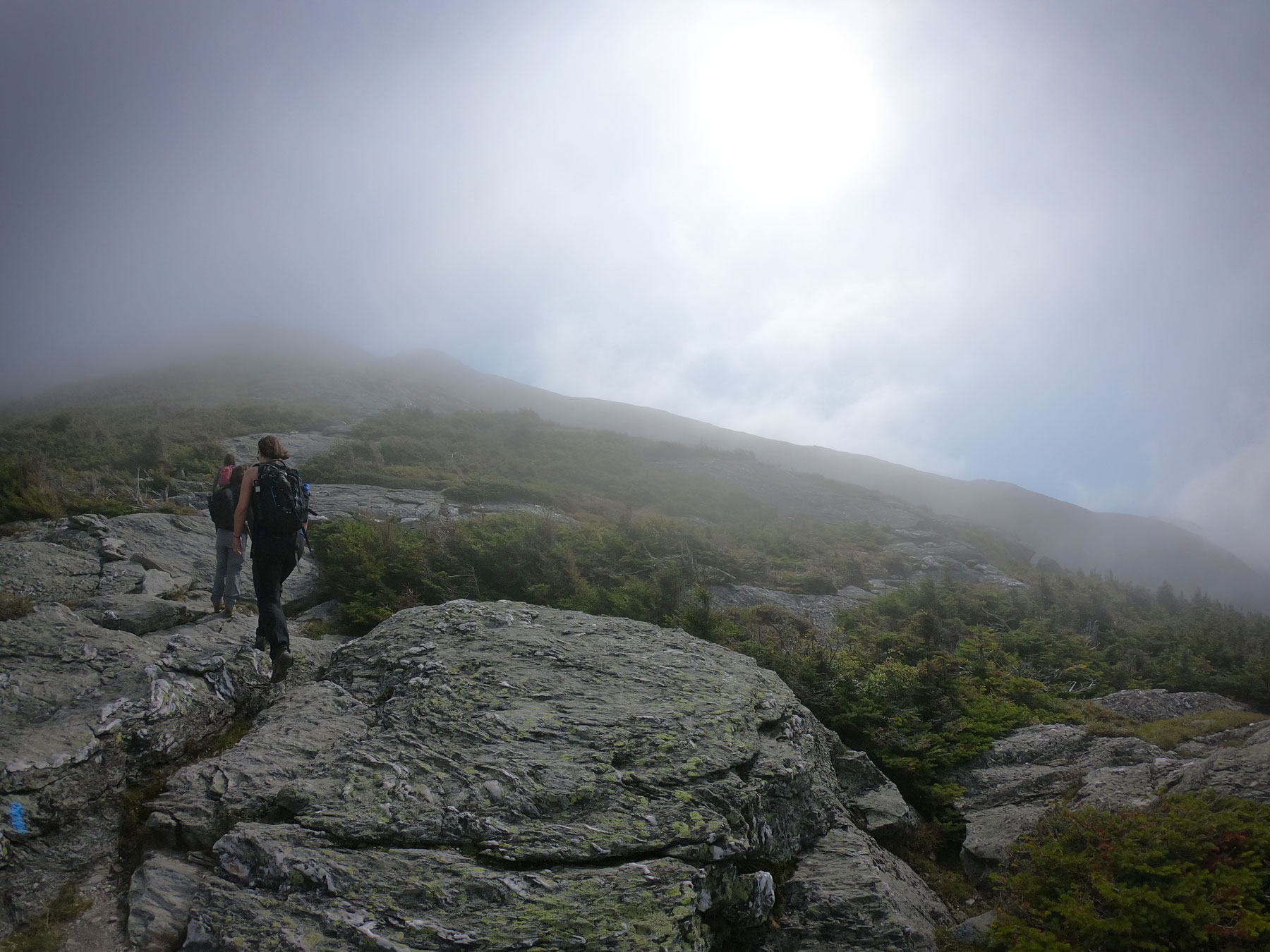 Two women hiking Sunset Ridge to top of Mount Mansfield, Vermont