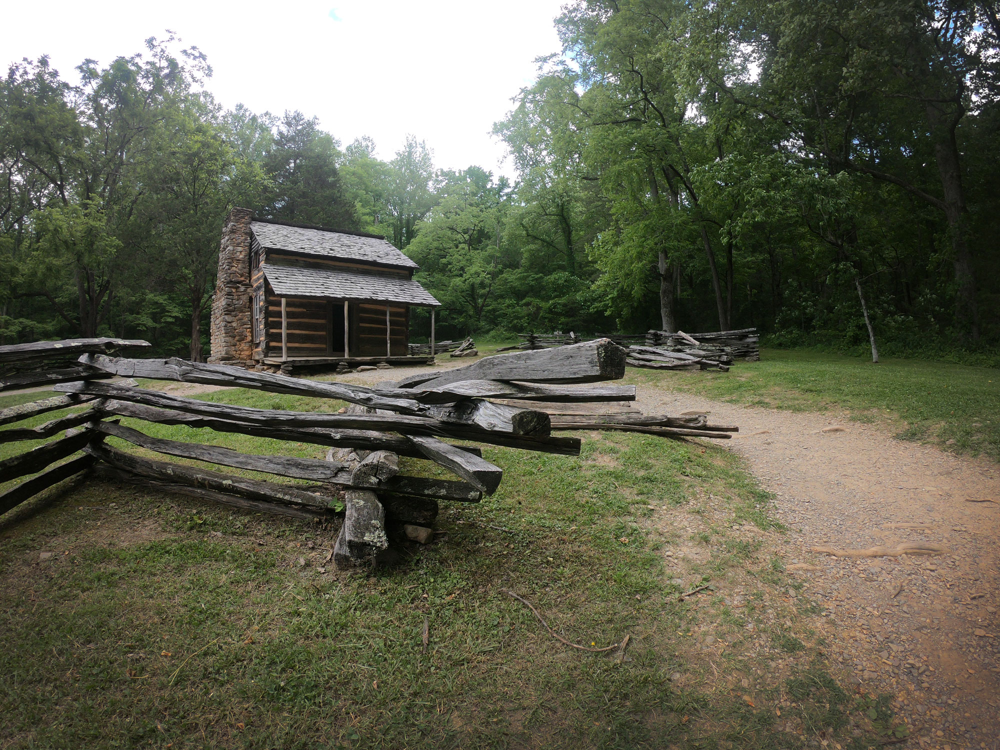 John Oliver Place cabin with zig zag fence in Cades Cove, Great Smoky Mountains National Park, Tennessee
